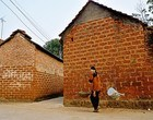 Duong Lam ancient village is famous for old brick houses.